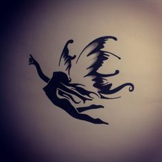 Flying Angel Tattoo Design In Black Color