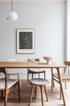 at home with avenue design studio. / sfgirlbybay modern wood dining table with mismatched wood chairs.