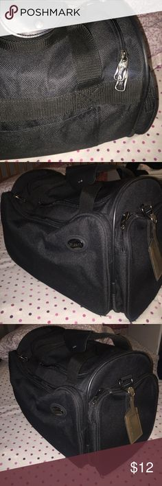 American Tourister duffle bag Used once. Excellent condition, no flaws. Black duffle. Very durable.  its approx. 18 inches in width. 10 inches in depth. And 12 inches in height. Discounts available on bundles. American Tourister Bags Duffel Bags
