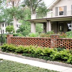 Patio idea - low curved red brick wall & paving | Barbara and John ...