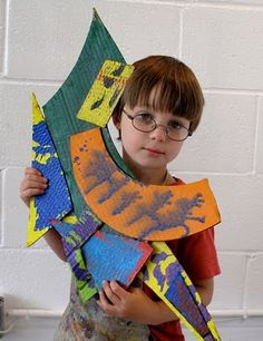 The ArtRoom cardboard sculpture. Frank Stella inspired abstract sculpture using cardboard and paint.