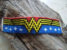 Wonder Woman Super Hero woven loom beaded bracelet Geek Nerdy sprite pixel comic from CylentBazaar on Etsy. Bead Loom Designs, Bead Loom Patterns, Peyote Patterns, Jewelry Patterns, Beading Patterns, Jewelry Ideas, Knitting Patterns, Card Weaving, Loom Weaving