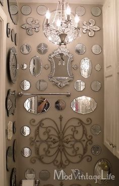 This is on a bathroom wall!  maybe a few less mirrors but the collage idea...