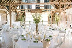 Love how clean and organic this green and white wedding decor is!