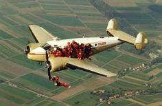 And Larry Was No More In This Photo: A man touching the propeller blade of a plane in mid air