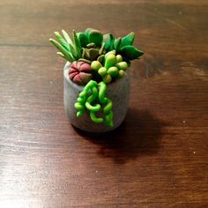 Miniature polymer clay succulent planter.  #polymerclay #succulent #cactus