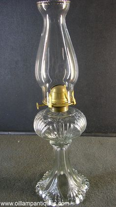 So far, we have been unable to identify the pattern of this EAPG (Early American Patterned Glass) oil lamp. However it does show characteristics that are similar to the Erin Fan pattern. The style of the stands, shape of the fonts and the dimensions of the lamps are all similar but this one lacks the sharp detail of the Erin Fan.