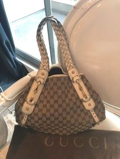 032c324f209 Gucci Pelham Monogram White  amp  Tan Canvas  Leather Hobo Bag. Hobo bags  are
