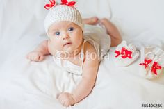 happy baby girl dressed in knitted bunny costume
