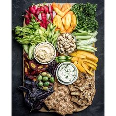 Crudité Platter With Hummus, Olives, Cheese Spread And Crackers. Get this and 70+ more Clean Eating recipes at https://feedfeed.info/clean-eating-recipes