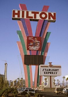 Sign for the Las Vegas Hilton, destroyed by storm in July The Stratosphere is seen under construction in lower left. Vegas Casino, Las Vegas Nevada, Vintage Neon Signs, I Love La, Old Signs, Construction, Photography, Alaska Travel, Alaska Cruise
