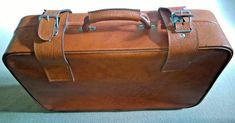 """Vintage Brown Faux Leather Suitcase with """" MADE IN GDR """" on the inside"""