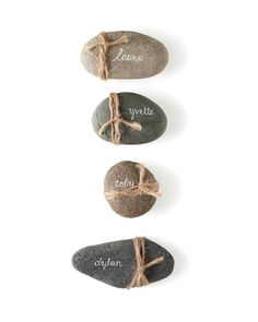 Knot some twine around flat stones for rustic wedding place cards. (Use a white paint pen or gel ink pen to write guests' names in script for an elegant contrast. Trendy Wedding, Rustic Wedding, Wedding Ideas, Wedding Photos, Rustic Place Cards, Rustic Place Card Holders, Vintage Place Cards, Diy Place Cards, Place Holder