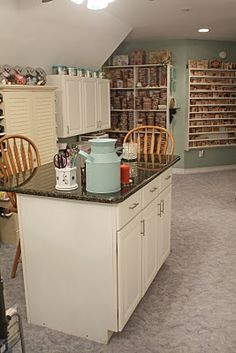 great craft room ideas - ribbon/storage rack behind rolling towers? : )