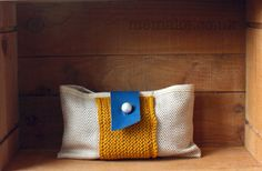 Handmade purse in linen, cotton knit and leather. Sewn in natural linen with a hand knitted central panel in mustard yellow cotton yarn. Fastens with a