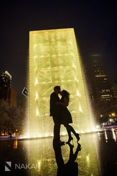 Best Chicago engagement pictures in Millennium Park at night. Love the lights, yellow, and shadows!  Chicago Engagement Photographer - Nakai Photography http://www.nakaiphotography.com