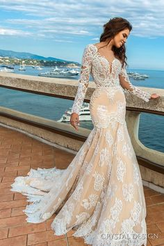 This in white https://dressmelodybeauty.storenvy.com/products/17286066-lace-wedding-dress-new-styles-boho-wedding-gown-with-long-sleeves-train-coun