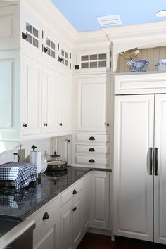 White Painted Cabinetry. Counter wall cabinet detail with ...