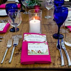 #Rustic #wood #tables look great with bright #magenta #linens and #colbalt #stemware www.classicaltents.com
