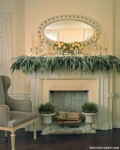 Mantel Greenery. Dripping crystal icicles dangle from a cedar-covered, snow-dusted mantelpiece to create a frosty scene. Soft powder, looking as if it floated down the chimney overnight, drifts around stacked wood and iron urns filled with silvery santolina.