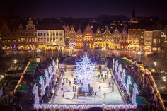 Markt in Brugge (Bruges), Belgium in winter for Christmas lit up at night.