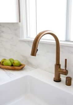 Ikea Upgrade: The SemiHandmade Kitchen Remodel - Remodelista Brushed bronze kitchen faucet Calcutta marble countertop Condo Kitchen Remodel, Cheap Kitchen Remodel, Apartment Kitchen, Apartment Ideas, Apartment Therapy, Ikea Hack Kitchen, Old Kitchen, Ranch Kitchen, Kitchen Ideas