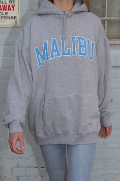 Soft heather grey hoodie with drawstrings, kangaroo pockets, and the Malibu graphic in light blue and white on the chest. Cute Lazy Outfits, Casual School Outfits, Teen Fashion Outfits, Trendy Outfits, Grey Hoodie, Sweater Hoodie, Trendy Hoodies, Cool Hoodies, Champion Clothing