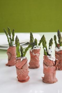 Asparagus Roast-Beef Roll Ups > roast beef,cooked asparagus, horseradish, cream cheese and maybe some pickle relish.  Party Food :D
