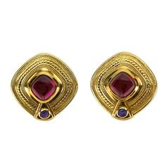 Wonderful signed Seidengang Earrings featuring cabochon oval Rubellite Tourmaline and faceted Sapphire set in 18k gold; beautifully worked D-ended square mountings