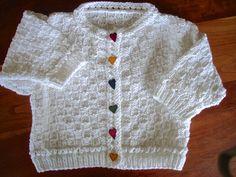 Hand knit little girl's cardigan sweater. Available at www.nwisman.etsy.com
