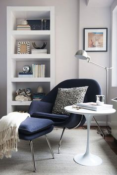 I like the light gray walls (half strength Benjamin Moore Gray Owl?), with white trim, modern chair and side table.Sacramento Street | Living With Great Style