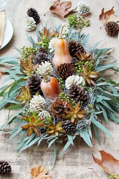 Easy DIY Thanksgiving Centerpieces for a Picture-Perfect Table : Create these pretty pinecones in just five minutes. Then, add them to berries, gourds, and succulents for a stunning Thanksgiving centerpiece. Diy Thanksgiving Centerpieces, Thanksgiving Table Settings, Rustic Wedding Centerpieces, Diy Centerpieces, Holiday Tables, Table Decorations, Thanksgiving Flowers, Kids Thanksgiving, Christmas Tables