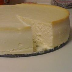 Eric's Best New York Style Cheesecake Recipe - This rich crustless cheesecake is flavored with amaretto rather than the traditional lemon. Serve with fresh sliced fruit or berries and fresh whipped cream. Amaretto Cheesecake, Ricotta Cheesecake, Best Cheesecake, Cheesecake Recipes, Dessert Recipes, No Crust Cheesecake, Homemade Cheesecake, Classic Cheesecake, Cheesecake Desserts