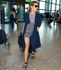 Caroline Flack turns heads at Heathrow in thigh-skimming dress #dailymail