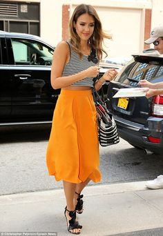 Dressed for success: Jessica donned a long sunset-yellow skirt and striped crop top for he...
