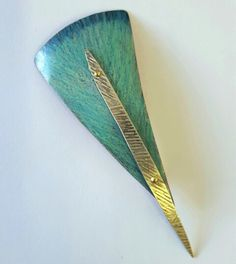 Feather brooch. Color pencil  on copper. Mary Karg