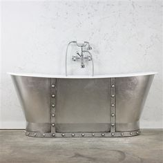 "'The Tintagel68' 68"" Cast Iron French Bateau Bathtub with Antiqued Faux Silver Leaf Exterior plus Accessories in Chrome"