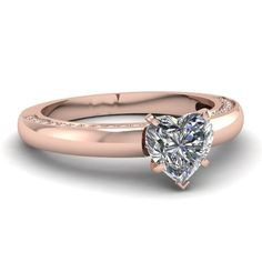simple rose gold wedding ring with heart diamond