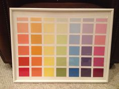 Paint swatch calendar! Paint swatches from Home Depot glued on canvas and framed. Use dry erase markers to write on the glass!