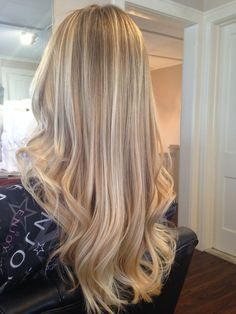 """What I love to call my """"blonde waterfall""""! Cascading beautiful blend of highlights, lowlights, blonde dimension and Balayage."""