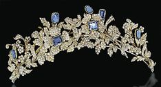This absolutely exquisite sapphire and diamond tiara is part of a demi-parure with a necklace and pin, c. 1830. The sapphires accent a floral-spray design.