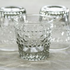 This beautiful mouth-blown glassware set by Nkuku is perfect for brunch, dinner parties and everyday use, and can impress your guests for your most lavish holiday event. Vintage inspired, these sweet glass cups are beautifully embossed, and work wonderful Rustic Kitchen Decor, Dining Decor, Kitchen Dining, Glass Material, Drinking Glass, Recycled Glass, Inspired Homes, Clear Glass, Glass Vase