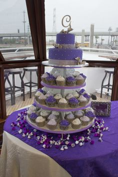 My Purple Wedding--Purple Cupcake -Cake for the Bride. I had silver edible pearls sprinkled on top of the cupcakes. I personally hand blinged the cupcake wrappers and blinged the cupcake stand.