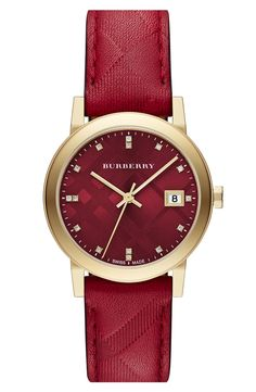 This red Burberry watch is the perfect addition to a stacked wrist.