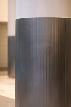 Fused Metal Column Covers offer a visually rich option for cladding existing structural columns. Interior Columns, Interior Walls, Shopping Mall Interior, Column Wrap, Pillar Design, Column Covers, Metal Wall Panel, Mall Design, Gym Design