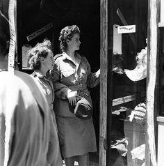 Canadian Women's Army Corps shopping in Italy during their off-duty hours, c.1944.