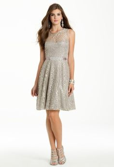 Betsy and Adam metallic lace sleeveless dress with illusion neckline and beaded satin ribbon waist.<br><br>•Scoop neckline<br>•Illusion lace bodice<br>•Satin tie waist<br>•Deep V back with center zipper