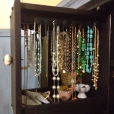 Pull out jewelry hanger in an armoire
