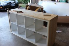 Unstained Wood-wrapped IKEA Kallax shelving unit