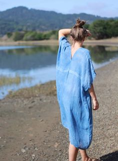 Lightweight linen gauze caftan. Naturally dyed in indigo-approximately 4 long dips to achieve this hue. There is a light resist over the chest in photo shown. Actual garment will be made without resist.Wash cold, line dry. Piece is made to order. One size fits most. Allow one week to ship.